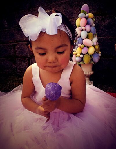 Little girl in party dress for Easter holiday.